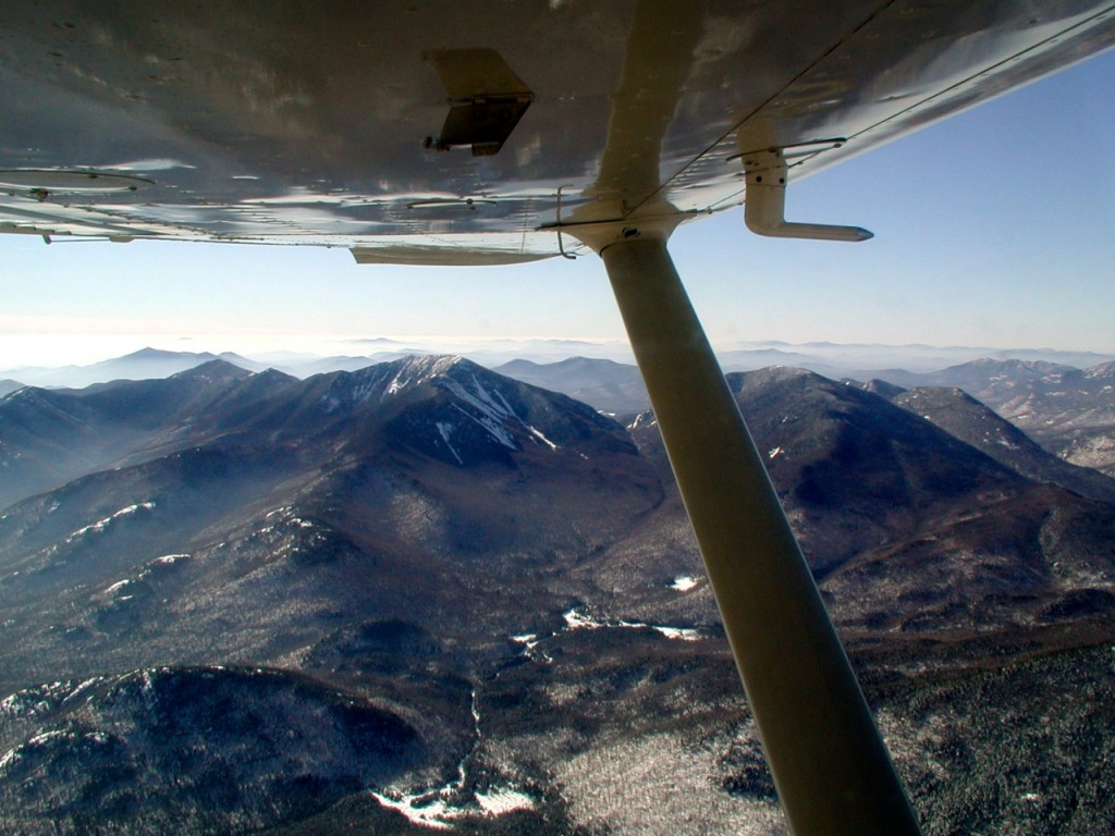 View of Mt. Marcy from Cessna 175 flying over the Keene Valley