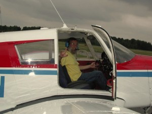 Russ as pilot in Cherokee 140