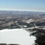 View of Lake Pleasant, Speculator Oak Mountain and the Adirondacks from about 9,500'
